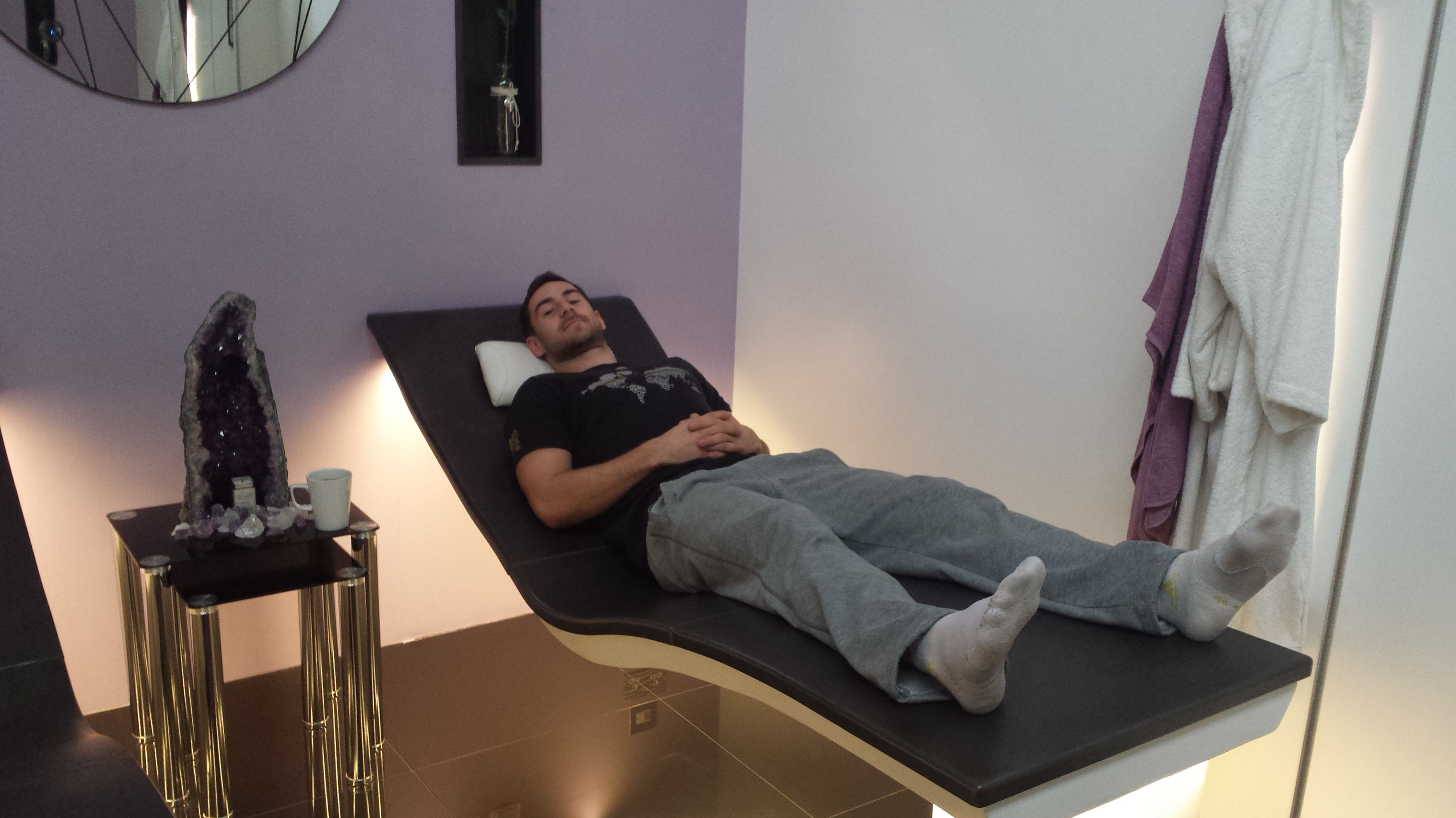 British Commonwealth silver medal winning athlete Ashley Bryant relaxing on one of the Sommerhuber heated loungers on display in the Dröm UK showroom.